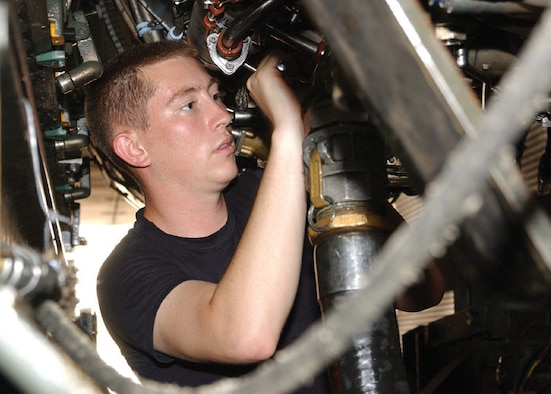 Senior Airman Joshua Spainhoward, 325th Maintenance Squadron propulsion flight jet engine mechanic at Tyndall Air Force Base, Fla., makes final test equipment connections prior to an engine maintenance test run inside Hush House No. 1. (U.S. Air Force photo by Tech. Sgt. Dan Neely)