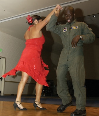Laura Garcia-Haas, owner of Garcia Dance Studio,  dances with Capt. Walter White, 392nd Training Squadron.  Capt. White was one of many who received dance lessons from Mrs. Garcia-Haas.