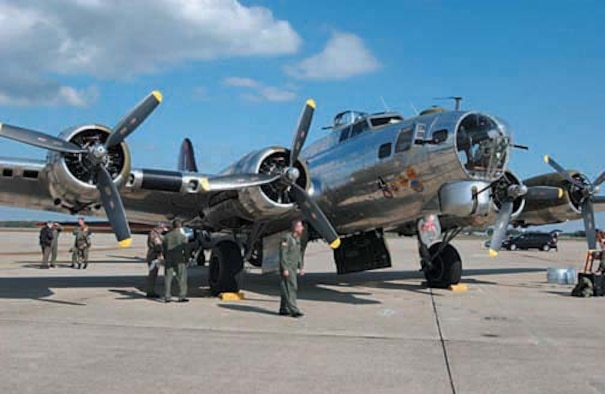 """Active-duty, Air Force Reserve and Air National Guard Airmen at Andrews Air Force Base, Md., get a close up look at a Boeing B-17 Flying Fortress on Oct. 12, 2006.  The """"Yankee Lady"""" is kept at the Yankee Air Museum in Belleville, Mich., and was at Andrews AFB for a flyover during the Air Force Memorial Dedication weekend at the Pentagon Oct. 14-15. (U.S. Air Force photo/Senior Airman Amaani Lyle)"""