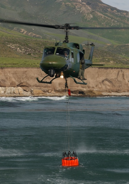 A crew from the 76th Helicopter Flight train using practices rescue techniques off the central coast of California. The 76th HF provides fire suppression post-launch disaster control and local wildland vegetation management.