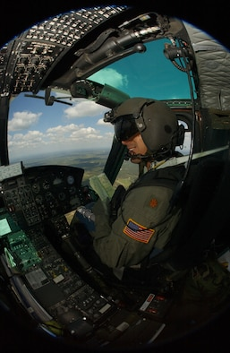 Major Ronald Frantz, Commander of the 76th Helicopter Squadron here, surverys the ground as he flys over Vandenberg. More than 60 percent 76th HS 1273 flying hours are spent training in a year.