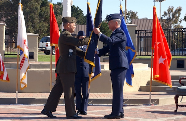 Marine General James Cartwright, USSTRATCOM commander, passes the flag to Maj. Gen. William Shelton, 14th Air Force commander, during the Joint Functional Component Command for Space Activation Ceremony here Tuesday. This signified the beginning of General Shelton's command of the JFCC SPACE.