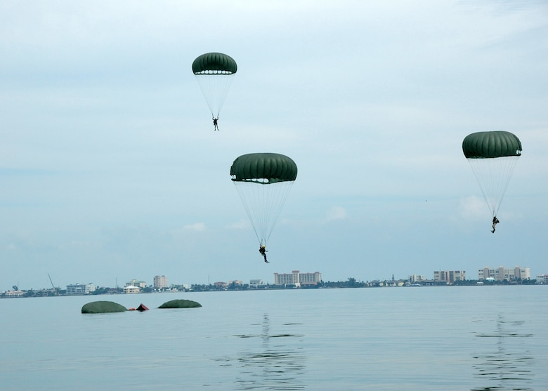 PJ trainees parachute into the Banana River.  (U.S. Air Force photo by Senior Airman Jonathan Simmons) (Released)
