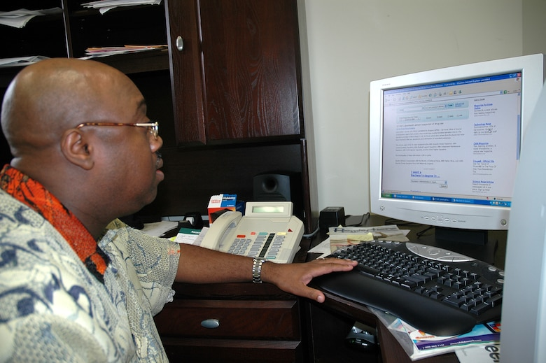 "PATRICK AFB, Fla. -- Andre Johnson, 45th Space Wing Drug Demand Reduction Program manager, researches past Red Ribbon Week campaigns as he finalizes plans for the 2006 Red Ribbon Week, Oct. 23- 31. The theme is ""United Against Drugs."" Mr. Johnson will speak with children at the Youth Center at Patrick AFB as well as two schools and a church. (U.S. Air Force photo by Staff Sgt. Patrick Brown)"