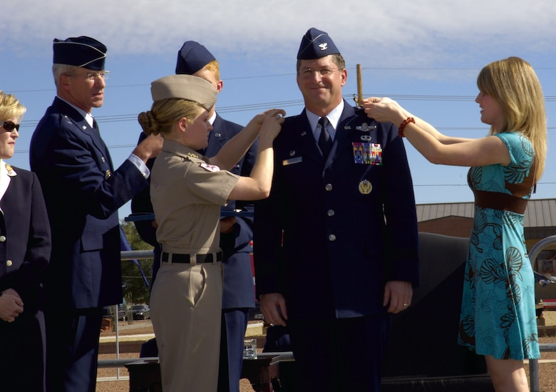Brig. Gen. David Goldfein, 49th Fighter Wing commander, is pinned on by his two daughters, Danielle and Diana Goldfein, during his promotion ceremony Oct. 13 at Heritage Park.