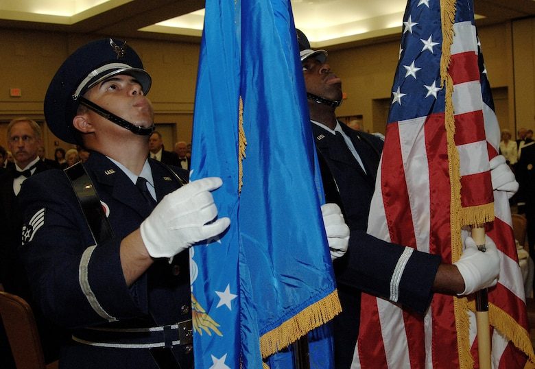 Staff Sgt. Rueben Moralez Jr., left, and Tech. Sgt, Ronrico Pace post the colors at the Air Force Villages dinner Oct. 20, 2006 at Lackland Air Force Base, Texas.  Air Force Chief of Staff General T. Michael Moseley spoke at the event. The Villages offer premier active living communities for retired and honorably seperated officers and their spouses, widows and widowers over the age of 62. (U.S. Air Force photo/Tech. Sgt. Larry A. Simmons)