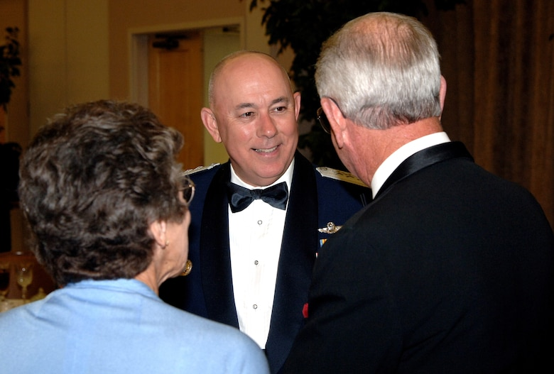 Air Force Chief of Staff General T. Michael Moseley talks with guests before dinner at the Air Force Villages dinner Oct. 20, 2006 at Lackland Air Force Base, Texas. The Villages offer premier active living communities for retired and honorably seperated officers and their spouses, widows and widowers over the age of 62. (U.S. Air Force photo/Tech. Sgt. Larry A. Simmons)