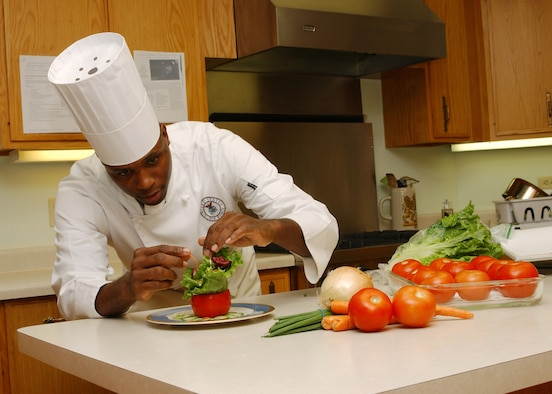 Master Sgt. Roy Bowser, enlisted aide for Gen. William R. Looney III, commander of Air Education and Training Command, prepares a salad for an official function. Sergeant Bowser was selected as the 2006 Enlisted Aide of the Year Award for the Senior-Aide Category Oct. 12. (U.S. Air Force photo by Melissa Peterson)