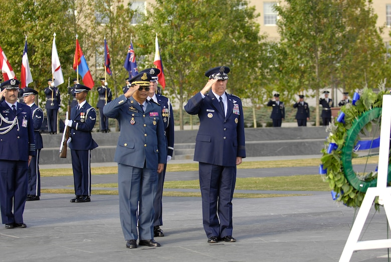 Air Force Chief of Staff Gen. T. Michael Moseley and Lt. Gen. Soeung Samnang salute during a foreign dignitary arrival and wreath-laying ceremony at the Air Force Memorial in Arlington, Va., on Tuesday, Oct. 24.  (U.S. Air Force photo/Senior Airman Desiree Andrejcik)