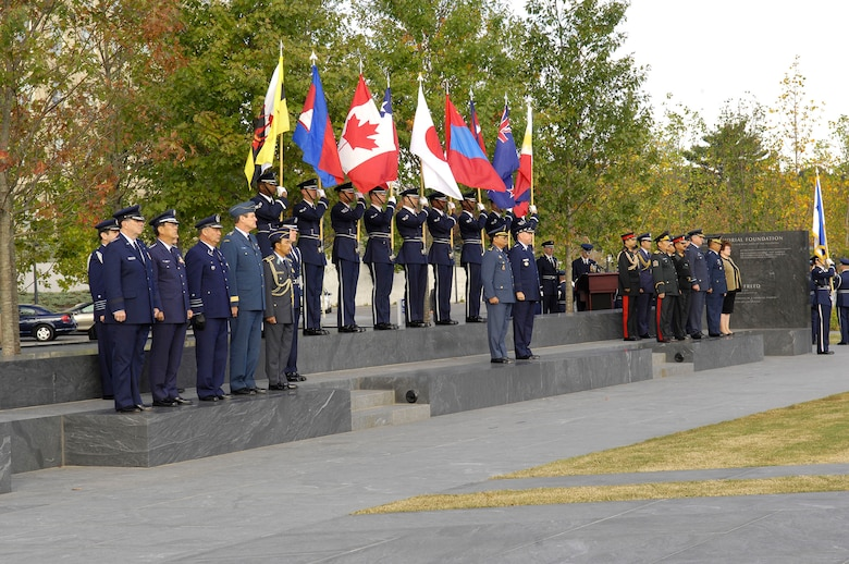 Air Force Chief of Staff Gen. T. Michael Moseley and Lt. Gen. Soeung Samnang, Cambodian Royal Air Force commander, attend a a foreign dignitary arrival and wreath-laying ceremony at the Air Force Memorial in Arlington, Va., on Tuesday, Oct. 24. The Pacific air chiefs from nine countries attended the event with Gen. Samnang representing them when he assisted General Moseley in the inspection of the troops. (U.S. Air Force photo/Senior Airman Desiree Andrejcik)