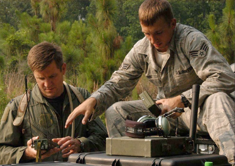 Senior Airman Kevin Wilson, 116th Operations Support Squadron Survival Evasion Resistance and Escape instructor, demonstrates proper operating techniques of the PRC -112 survivor radio to an Aircrew member. (U.S. Air Force photo/Senior Airman Paul R. Ross)