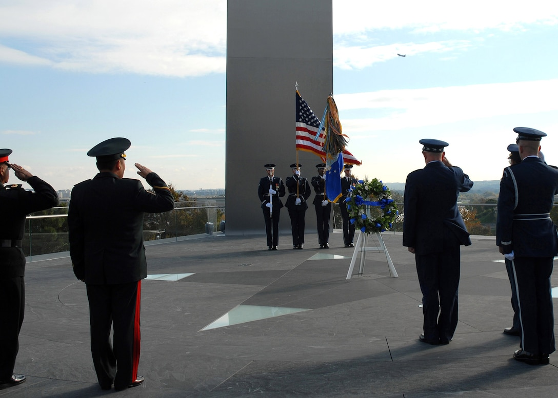 Chief of Staff of the Air Force Gen. T. Michael Moseley and Pacific Air Chiefs from Brunei, Cambodia, Canada, Chile, Japan, Mongolia, Nepal, New Zealand and the Philippines salute while Taps is played during a foreign dignitary arrival and wreath laying ceremony Tuesday, Oct. 24, 2006, at the Air Force Memorial.  (U.S. Air Force photo/Staff Sgt. Madelyn Waychoff)