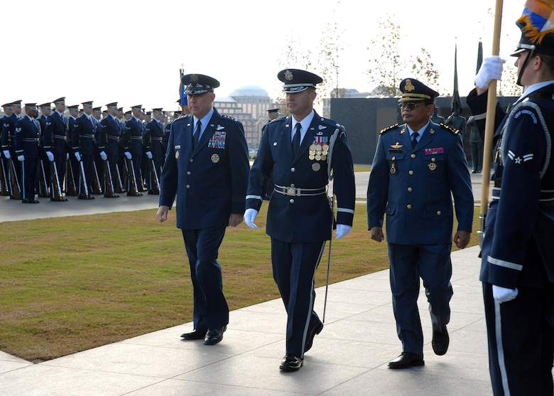 Chief of Staff of the Air Force Gen. T. Michael Moseley and Lt. Gen. Soeung Samnang, Cambodian Royal Air Force commander, are escorted by Lt. Col. Gaylord Thomas, Air Force Honor Guard commander, to inspect the troops during a foreign dignitary arrival and wreath laying ceremony Tuesday, Oct. 24, 2006, at the Air Force Memorial. (U.S. Air Force photo/Staff Sgt. Madelyn Waychoff)