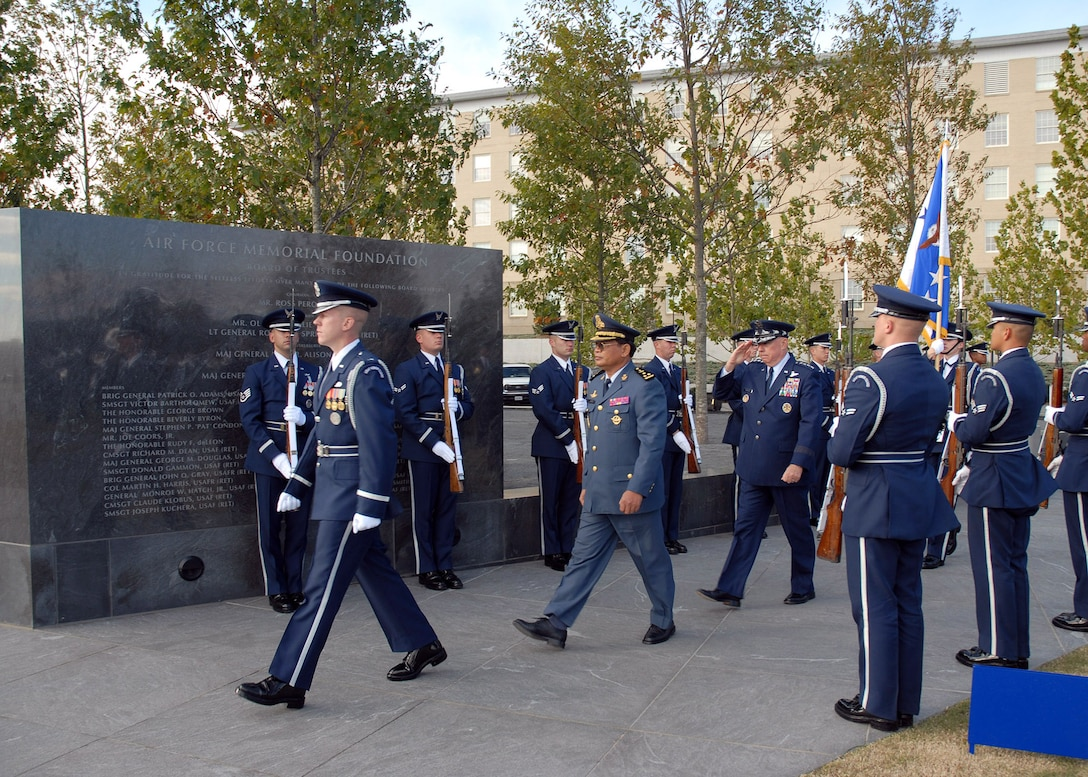 1st Lt. John Shirley from the Air Force Honor Guard escorts Chief of Staff of the Air Force Gen. T. Michael Moseley and Lt. Gen. Soeung Samnang, Cambodian Royal Air Force commander, to their positions during a foreign dignitary arrival and wreath laying ceremony Tuesday, Oct. 24, 2006, at the Air Force Memorial. (U.S. Air Force photo/Staff Sgt. Madelyn Waychoff)
