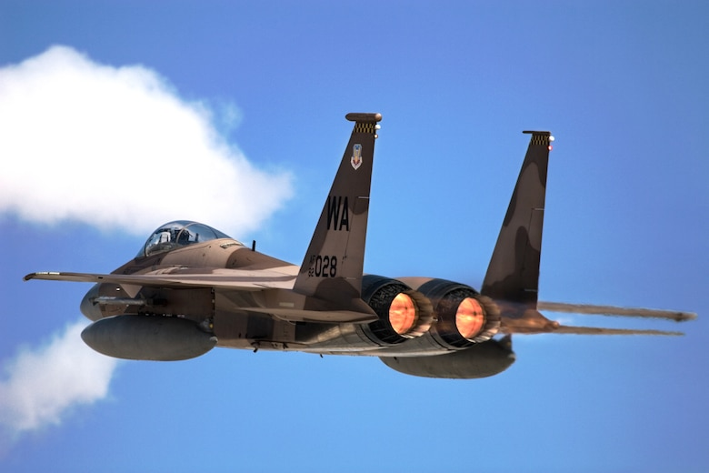 An F-15 with the 65th Aggressor Squadron takes off from Nellis Air Force Base, Nev., Oct 18. F-15 and F-16 aggressor aircraft took part in Red Flag, which ended Oct. 20, 2006. Red Flag subjects U.S. and allied aircrews  to the most dynamic, intense and realistic combat training in the world today. (Photo courtesy Dave Cibley)