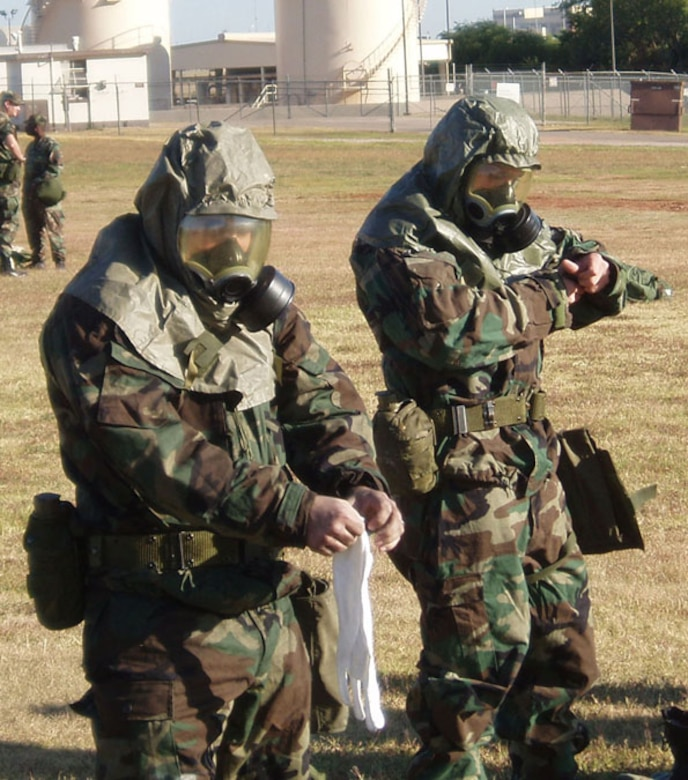 507th Air Refueling Wing members don their chemical protective gear during the October drill weekend while attending an Ability To Survive and Operate Fair.  The ATSO Fairs are being hosted by wing Exercise Evaluation Team members in preparation to the wing's 2007 Oerational Readiness Inspection.  While at ATSO Fair members visit various stations to refresh their skills on Self Aid Buddy Care, facility hardening and management techniques.