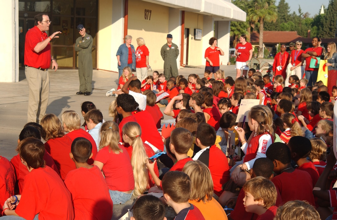 Kerry Bringman, 39th Medical Group drug demand reduction program manager, talks to Incirlik American School elementary school students about the dangers of drugs after the Red Ribbon Week parade Oct.  26.