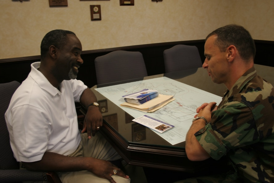Vernon A. Reddick, left, 39th Air Base Wing school liasion officer, talks with Col. Ken Stefanek, 39th ABW vice commander, about various subjects ongoing at Incirlik American School on Oct. 27. Mr. Reddick was the inagural winner of the Department of Defense Education Activity Military Unity Commander Excellence Award. (U.S. Air Force photo by Staff Sgt. Oshawn Jefferson)