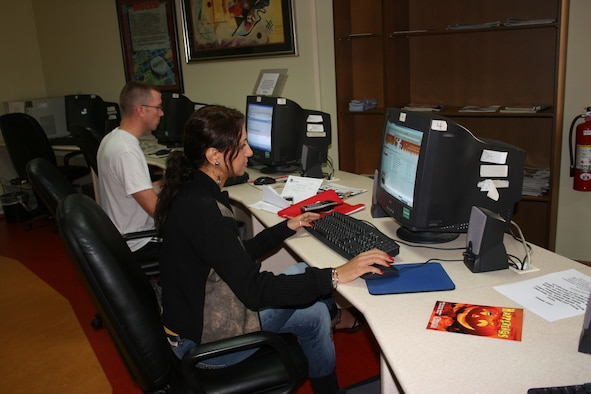 Two members of the Incirlik community take advantage of the Cyber Cafe inside of the community center Oct. 26. (U.S. Air Force photo by Staff Sgt. Oshawn Jefferson)