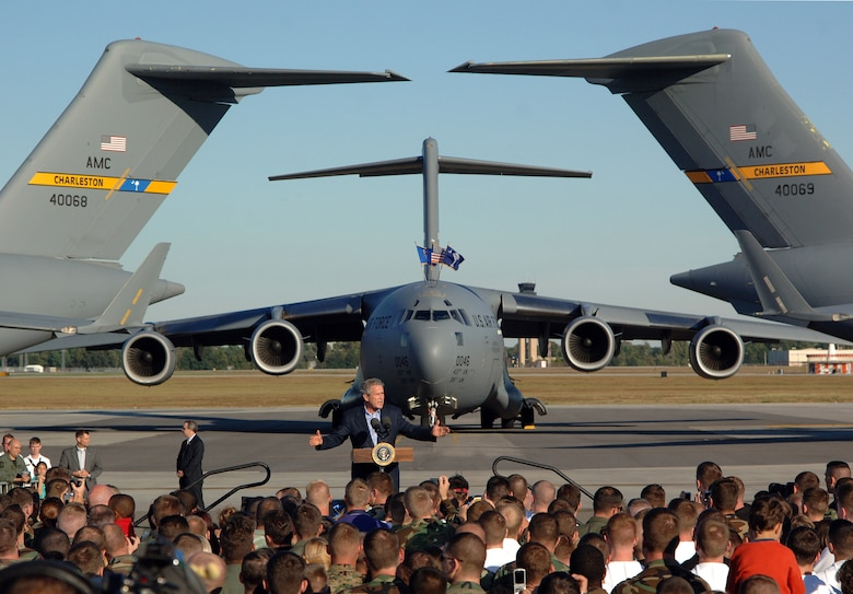 President George W. Bush delivers a speech in front of several C-17 Globemaster IIIs at Charleston Air Force Base, S.C., Oct. 28. More than four thousand servicemembers and families attended the presidential rally were he spoke on the war on terrorism. (U.S. Air Force photo/Tech. Sgt. Larry A. Simmons)