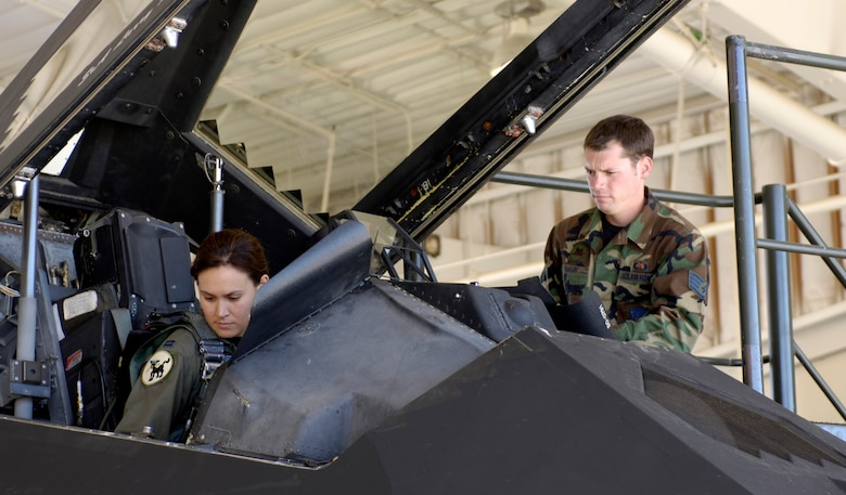 Capt. Christina Szasz prepares an F-117 Nighthawk for takeoff at Holloman Air Force Base, N.M. Oct. 27. The plane was part of a 25-plane formation celebrating the Nighthawk's 25th anniversary and 250,000 flying hour. The planes were separated into five groups and flew over the base to end the celebration ceremony. (U.S. Air Force photo/Senior Airman Brian Ferguson)