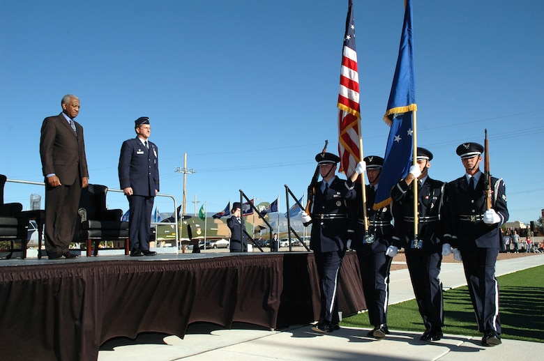 """Brig. General Dave """"Fingers"""" Goldfein and retired General Lloyd """"Fig"""" Newton await the posting of the colors by the Holloman Honor Guard during the Silver Stealth celebration Oct. 27, 2006."""