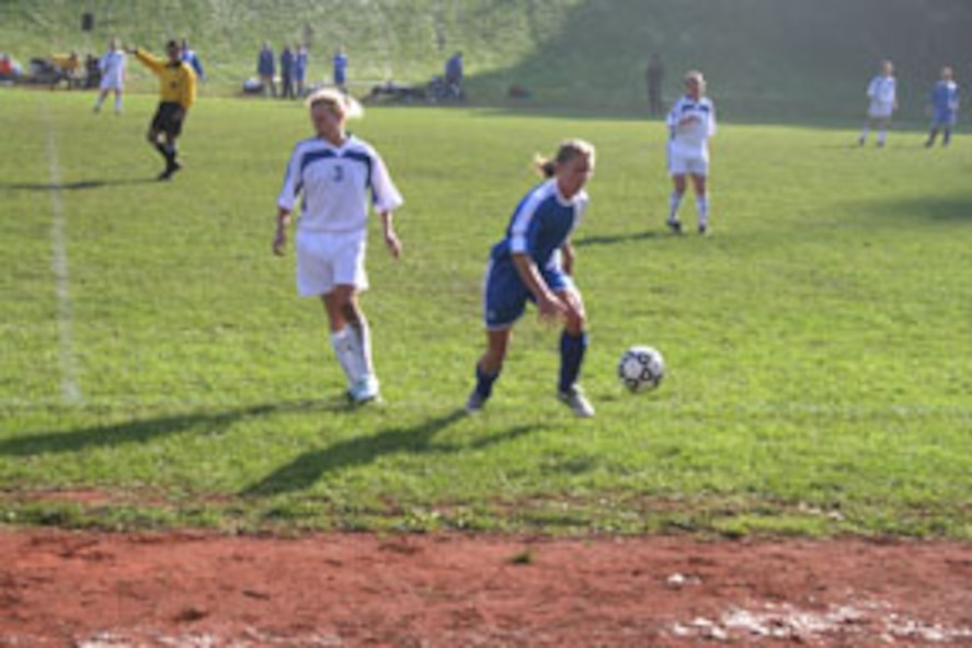 Jodi Whitener, Incirlik Women's Soccer Team midfielder, chases the ball out of bounds to throw it in against the Lakenheath women's team Oct. 18. The Incirlik Women's Soccer Team finished third at the U.S. Air Forces in Europe Soccer Tournament at Sembach Air Base, Germany, Oct. 16 to 20. (U.S. Air Force photo by Senior Airman Tim Beckham)