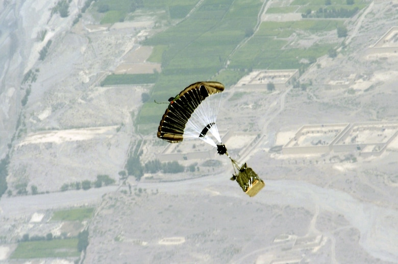 A new Global Positioning System-guided Joint Precision Air Drop System bundle, known as Screamer 2K, floats to the ground after being dropped from the back of a C-130 Hercules over Afghanistan Aug. 31. The drop was made from 17,500 feet above sea level, and was the first joint Air Force-Army operational drop of JPADS in the U.S. Central Command area of responsibility. Four bundles were dropped from the Alaska Air National Guard C-130. All four bundles arrived at the drop zone, resupplying Army troops on the ground with ammunition and water. (U.S. Air Force photo/Senior Airman Brian Ferguson)