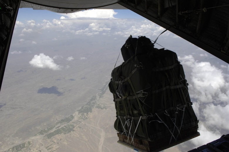 The new GPS guided Screamer 2K bundle, Joint Precision Air Drop System, fall out of the back of a C-130 Hercules over Afghanistan Aug. 26, 2006.  The drop was made from 17,500 feet above mean sea level, and was the first joint Air Force Army operational drop of JPADS in the Central Command Area of Responsibility.  Four bundles were dropped from the Alaska Air National Guard C-130.  The system is designed to provide precision airdrops from high altitudes, elimination the treat of small arms fire.  All four bundles arrived at the drop zone, less than 25 meters from the desired target.    