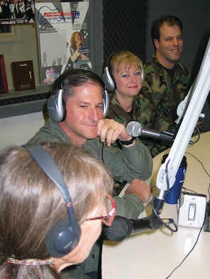 A light moment as Col. Dave Goldfein, 49th Fighter Wing commander, Chief Master Sgt. Marjorie McNichols, 49 FW command chief, and Capt. Joel Stark, 49 FW Public Affairs, discuss Holloman events with co-host Ms. Jean Vallance during a live radio interview at KRSY-FM in Alamogordo Aug. 29.