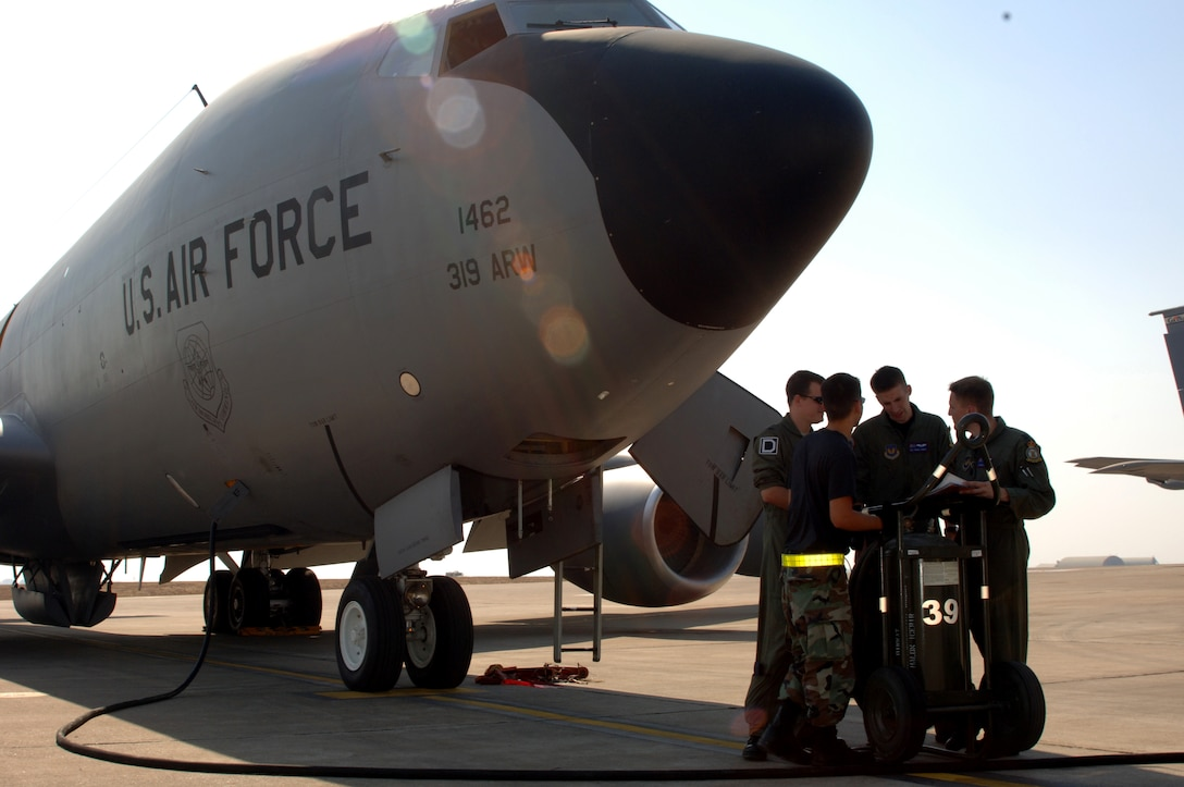 Members of the 90th EARS talk about their preflight inspection before taking off on a mission Sept. 5. (U.S. Air Force photo by Airman 1st Class Nathan Lipscomb)