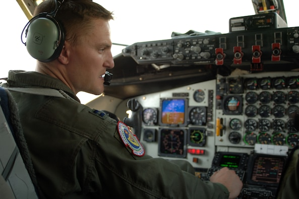 Capt. Jason Sovers checks the instruments during a preflight inspection Sept. 5. Captain Sovers is a pilot from RAF Mildenhall, England, currently attached to the 90th EARS. (U.S. Air Force photo by Airman 1st Class Nathan Lipscomb)