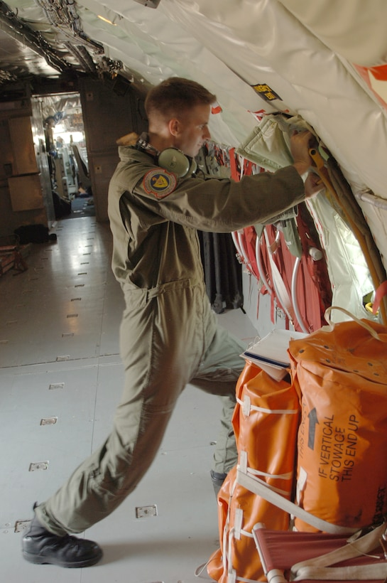Senior Airman Thomas Nance puts up an insulation panel inside of a plane on Sept. 5. Airman Nance is part of the 90th Expeditionary Air Refueling Squadron. (U.S. AIr Force photo by Airman 1st Class Nathan Lipscomb)