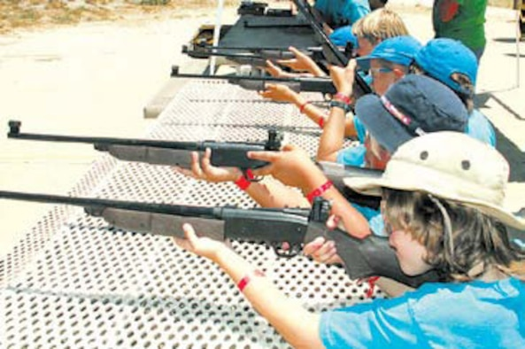 Webelo Scouts take aim at their targets as they prepare to qualify on how to safely use BB guns.