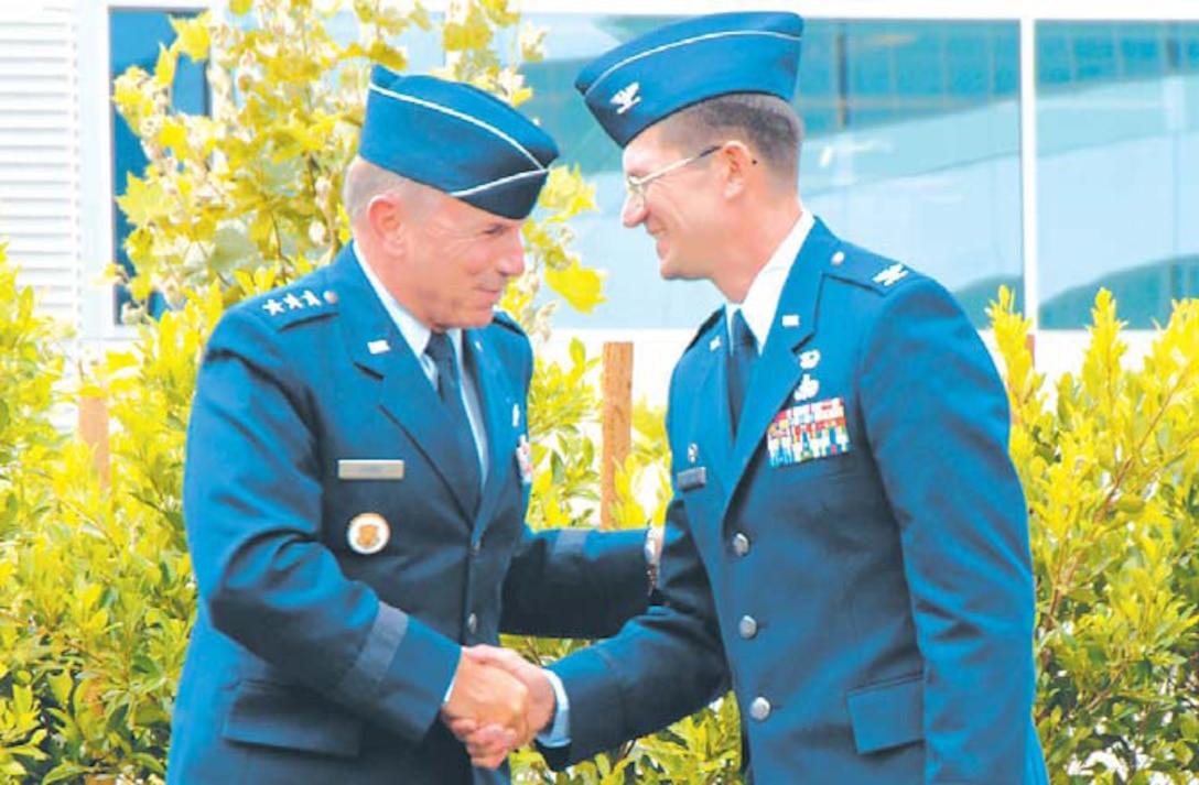 Lt. Gen. Michael Hamel (left), Space and Missile Systems Center commander, welcomes aboard the 61st Air Base Wing commander, Col. Joseph Schwarz. The Wing stand-up took place at the Los Angeles Air Force Base?s Schriever Space Complex courtyard, July 31.