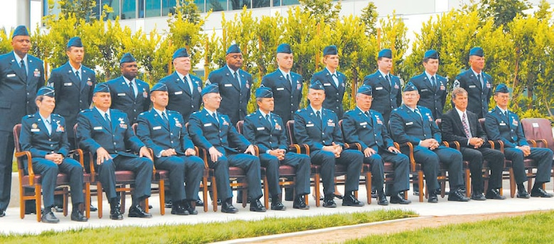 The new wing and group commanders assemble at the Schriever Space Complex courtyard during the Wing activation ceremony. They are (front row, left to right); Brig. Gen. Ellen Pawlikowski, Military Satellite Communications Systems Wing commander; Col. David O?Brian, representing Brig. Gen. (s) Edward Bolton, Launch and Range Systems Wing commander; Col. Allan Ballenger, Global Positioning Systems Wing commander; Col. Randall Weidenheimer, Space Based Infrared Systems Wing commander; Col. Michael Taylor, Space Superiority Systems Wing commander; Col. Richard White, Space Development and Test Wing commander; Col. John Wagner, Defense Meteorological Satellite Program Systems Group commander; Col. Michael Coolidge, Satellite Control and Network Systems Group commander; Mr. Lou Johnson, Space Logistics Group director; and Col. Joseph Schwarz, 61st Air Base Wing commander. Their Senior NCOs stand solidly behind them.