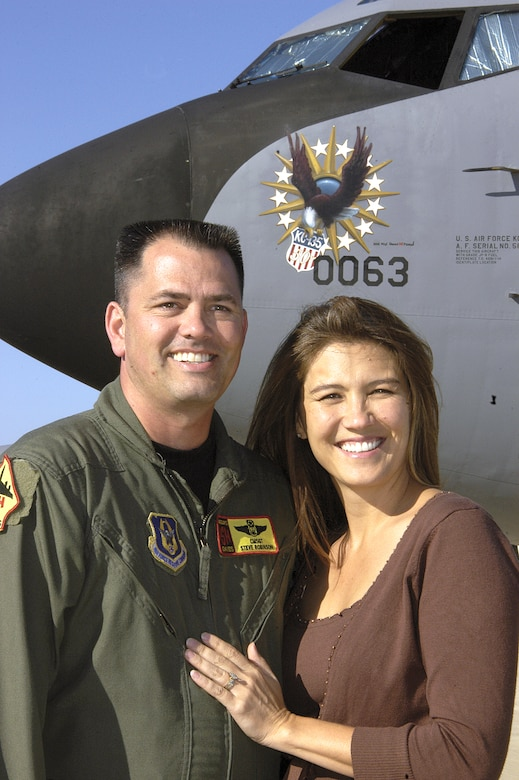 "Chief Master Sgt. Steven Robinson and his wife Justine said ""I do"" aboard a KC-135 Stratotanker 15 years ago. Today, in front of the familiar aircraft with special 50th anniversary nose art, they reminisce about their marriage's unconventional beginning. (U.S. Air Force photo/Margo Wright)"
