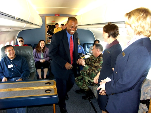 Bosses of 932nd Airlift Wing reservists enjoy a laugh during their employer flight on board a C-9C during Boss Day.  The flight attendants took care of the employers by serving meals.  Are you interested in becoming an Air Force Reserve Command flight attendant, pilot or maintainer?  Call 1-800-257-1212 for more information.