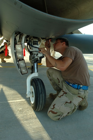 Senior Airman Airman Bradley Schuster performs post-flight maintenance on an F-16 Fighting Falcon at Balad Air Base, Iraq, Sept. 9. Airman Schuster is deployed from Cannon Air Force Base, N.M., and is assigned to the 332nd Expeditionary Aircraft Maintenance Squadron. (U.S. Air Force photo/Airman 1st Class Chad M. Kellum)