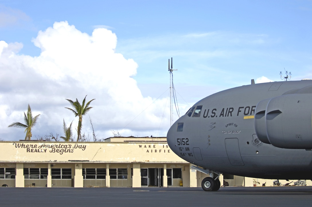 A C-17 Globemaster III sits in front of the airfield operations building on Wake Island Sept. 12. The C-17, from the 535th Airlift Squadron at Hickam Air Force Base, Hawaii, flew a 53-person team to the island to assess damage left by Super Typhoon Ioke after it hit the island Aug. 31. (U.S. Air Force photo/Tech. Sgt. Shane A. Cuomo)