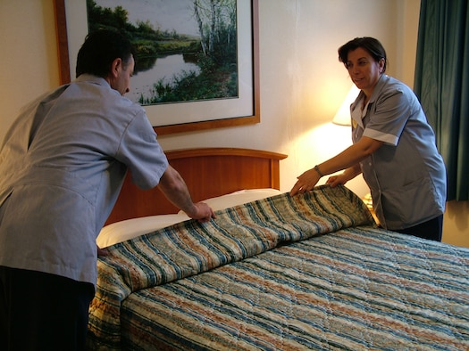 Two housekeepers make a bed at the Hodja Inn. The Hodja Inn was the winner of the 2006 Innkeeper Award. (Courtesy photo)