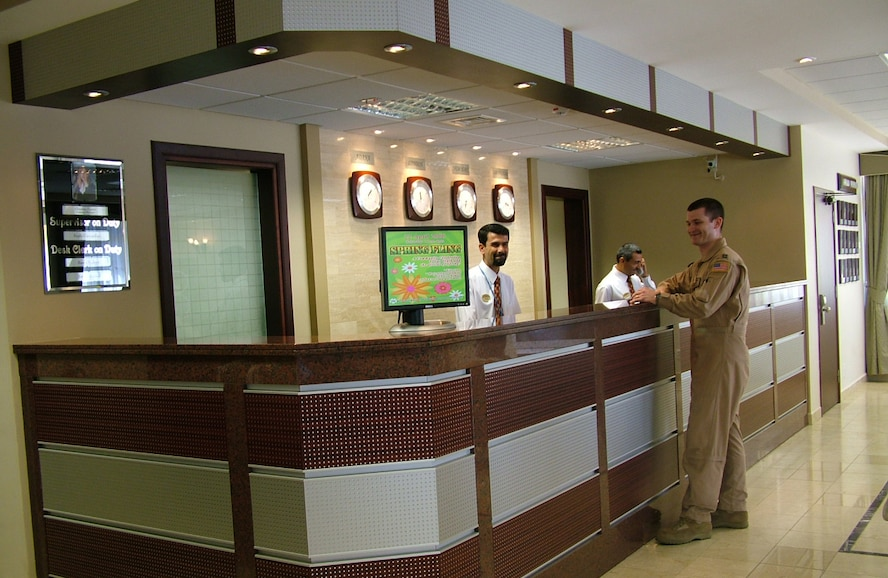 A customer gets helped by staff members at the front desk of the Hodja Inn at Incirlik Air Base, Turkey. The Hodja Inn won the 2006 Inkeeper Award. (courtesy photo)