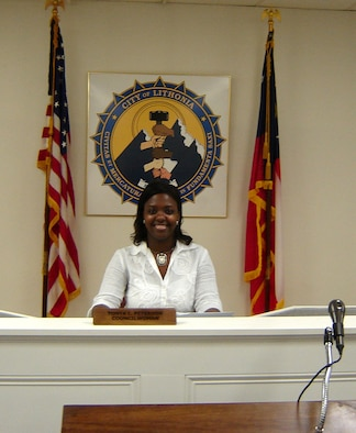 As a chaplain's assistant, Air Force Reservist Tech. Sgt Tonya Peterson sergeant helps minister to the spiritual needs of the 908th Airlift Wing members. In her civilian life she's helping minister to the needs of residients of Lithonia, Ga., as that city's youngest elected official. In January 2006, the civilian property manager was elected to an at large seat on the Lithonia City Council. (Courtesy Photo)
