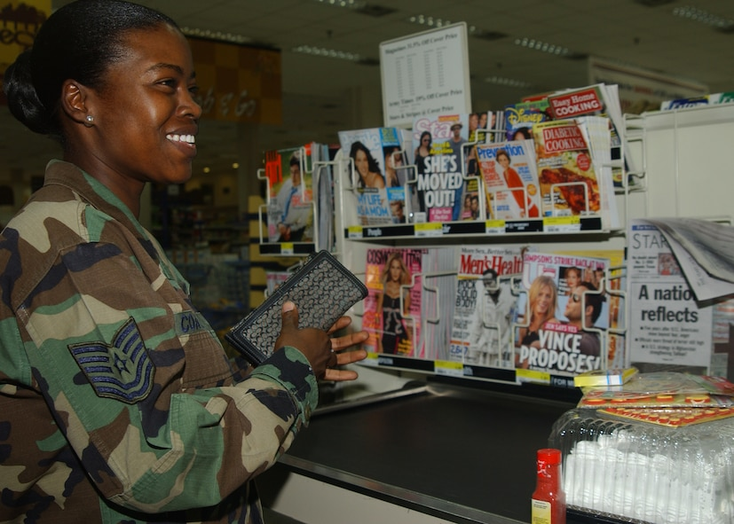Tech . Sgt. Nechelle Coates, 39th Air Base Wing manpower office, checks out at the Commissary here Thursday. (U.S. Air Force photo by Airman Kelly LeGuillon)
