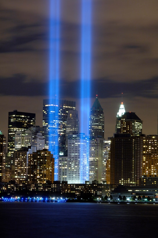 """The """"Tribute in Light"""" memorial is in remembrance of the events of Sept. 11, 2001, in honor of the citizens who lost their lives in the World Trade Center attacks. The two towers of light are composed of two banks of high wattage spotlights that point straight up from a lot next to Ground Zero. This photo was taken from Liberty State Park, N.J., Sept. 11, the five-year anniversary of 9/11. (U.S. Air Force photo/Denise Gould)"""