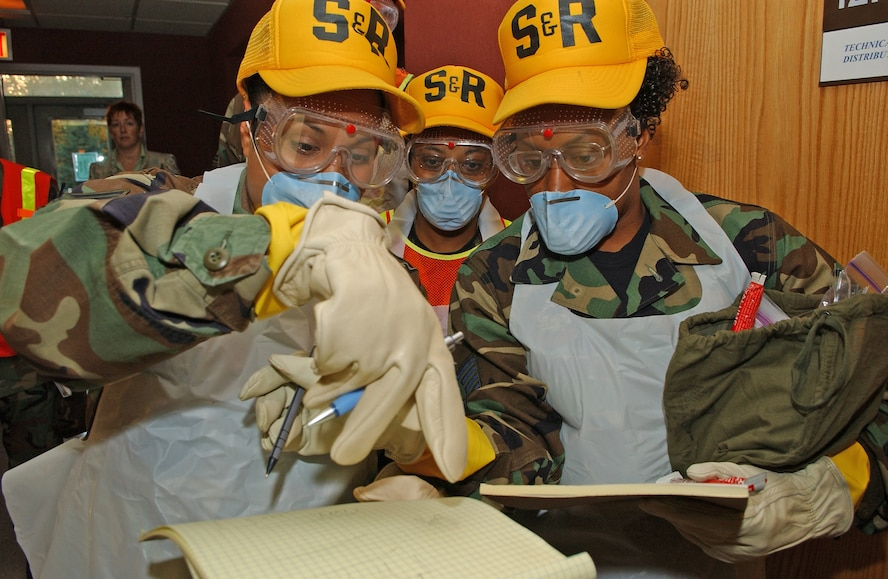 Staff Sgt. Susannah Lutchman-Hertel (left) and Staff Sgt. Talisa Arnold plot and record body parts during the Arctic Gold 06-08 Emergency Mangement Exercise during the 354th Fighter Wing's Unit Compliance Inspection on Sept. 11, 2006. Both Staff Sergeant's are assigned to the 354th Services Squadron, 354th Mission Support Group, 354th Fighter Wing, Eielson Air Force Base, Alaska. (USAF Photo by Senior Airman Anthony Nelson Jr)