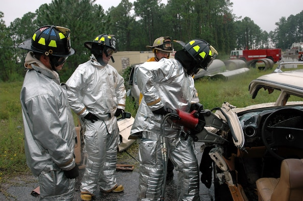"Hurlburt Field firefighters practice operating the ""Jaws of Life"" during a training session Monday here. (U.S. Air Force Photograph by Jamie Haig)"