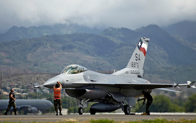 Crew chiefs recover their F-16 Fighting Falcon after it returned to Hickam Air Force Base, Hawaii from an air to air mission Sept. 8, 2006 during Exercise Sentry Aloha. The crew chiefs are from the Texas Air National Guard 149th Fighter Wing.  The exercise brings dissimilar combat assets to Hickam to train with the Hawaii Air National Guard's 199th Fighter Squadron. (U.S. Air Force photo/ Tech. Sgt. Shane A. Cuomo)