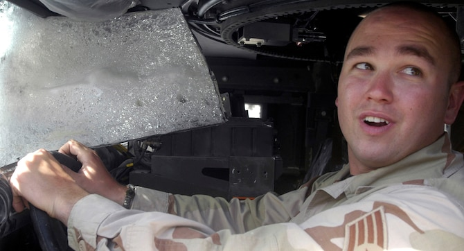 Staff Sgt. Mike Myers sits in the driver's seat of a Humvee he was operating when it was hit by a rocket-propelled grenade. The attack came Sept. 6 at almost the same time his son was being born in the United States. Sergeant Myers is a security forces member deployed to the Bagram Provincial Reconstruction Team from Goodfellow Air Force Base, Texas. (U.S. Air Force photo/Maj. David Kurle)