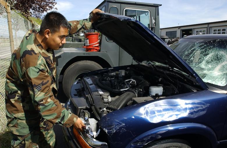 Senior Airman Octavio Ortega, 31st Logistics Readiness Squadron vehicle maintenance customer service representative, works on a damaged government owned vehicle Sept. 6.